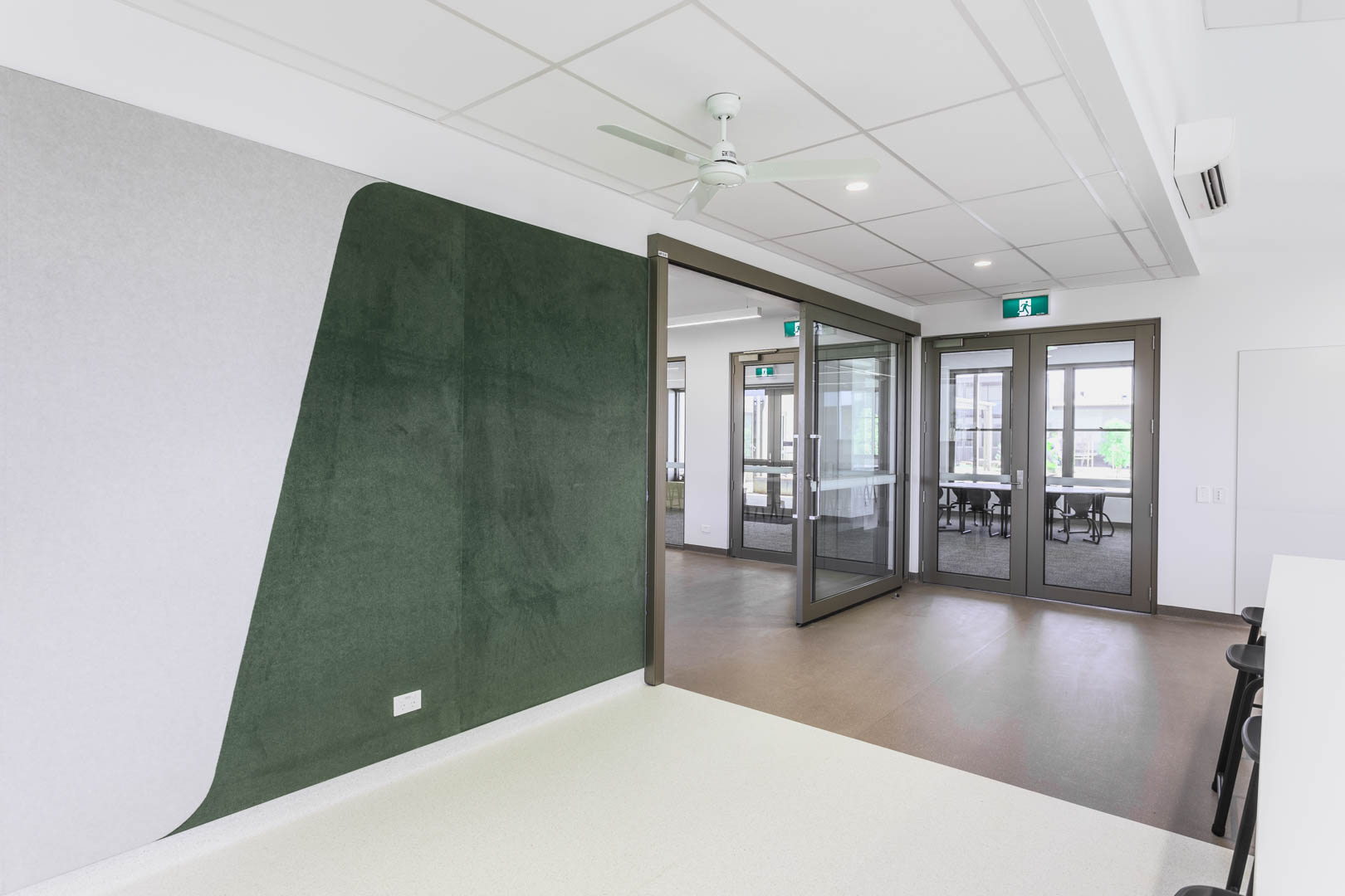 an open acoustic glazes sliding door system inside a GLA