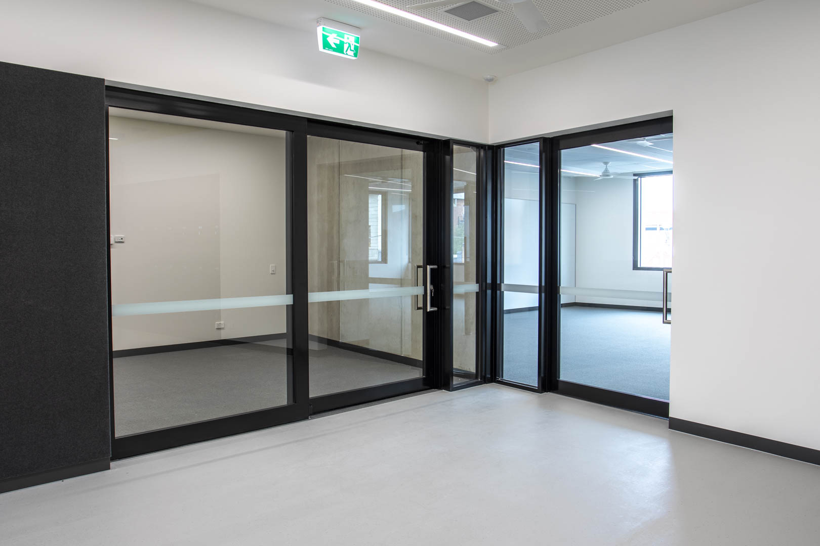 image of a GLYDE acoustic sliding door in a high school