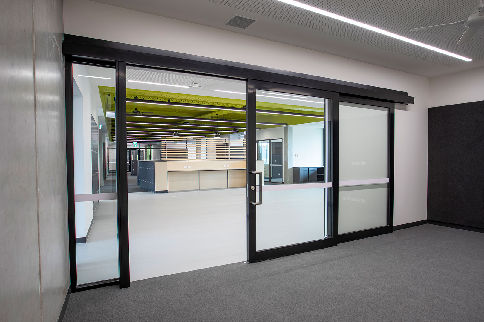 image of a GLYDE acoustic sliding door at a high school