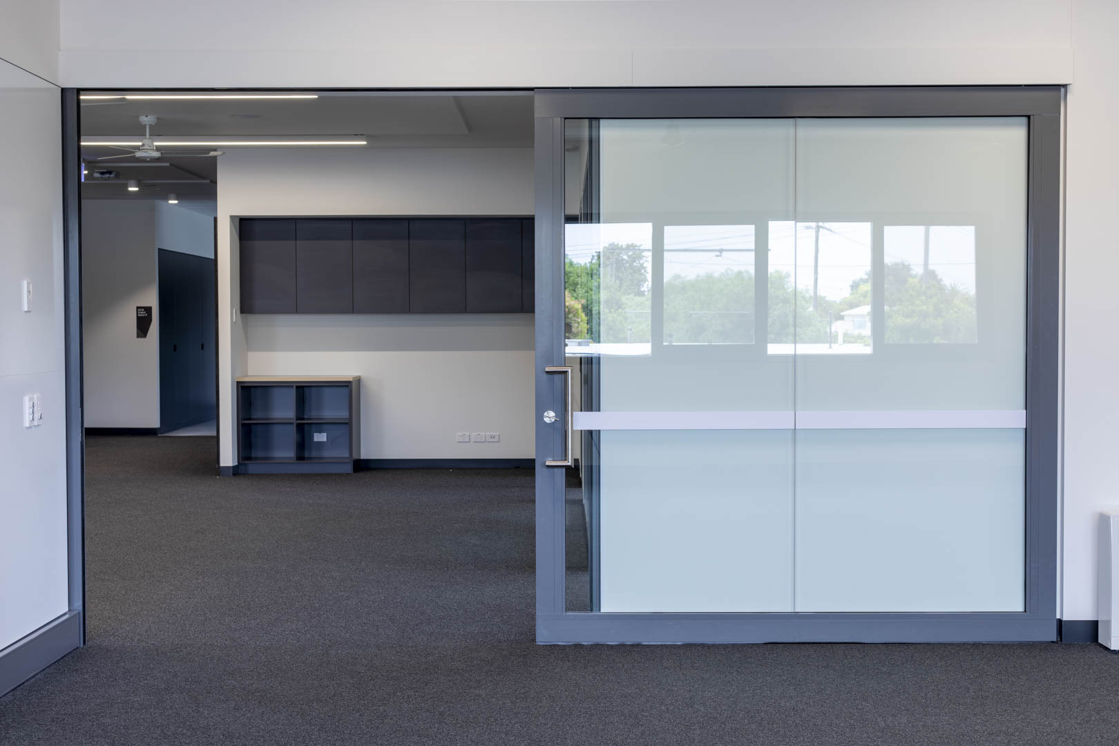 image of a GLYDE acoustic slider with the door open