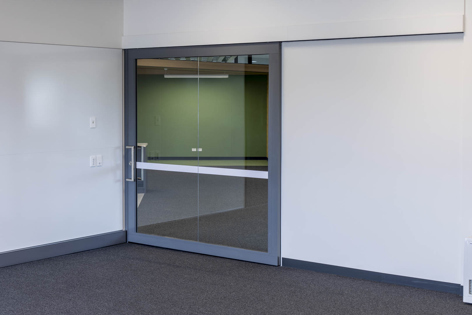 image of an acoustic glazed slider in a high school with the door closed