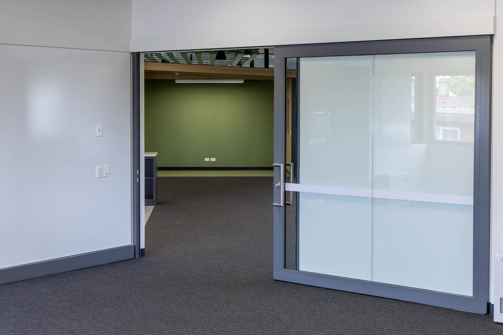 image of an acoustic glazed slider in a high school with the door open