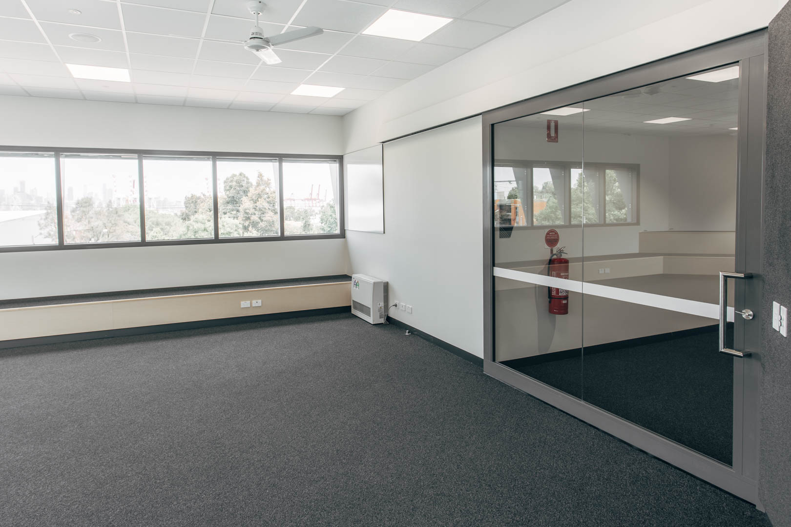 image of a glazed acoustic sliding door installed in a Victoria high school