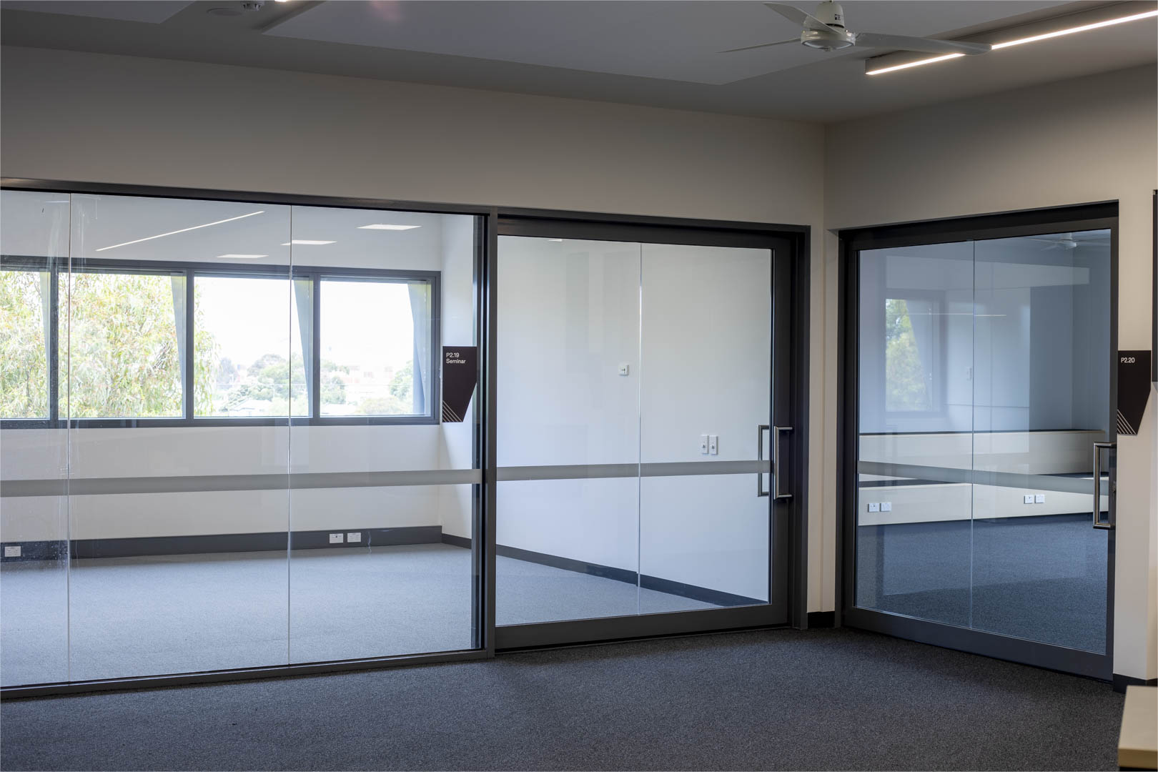 image of a school's acoustic glazed sliding doors with the doors both closed