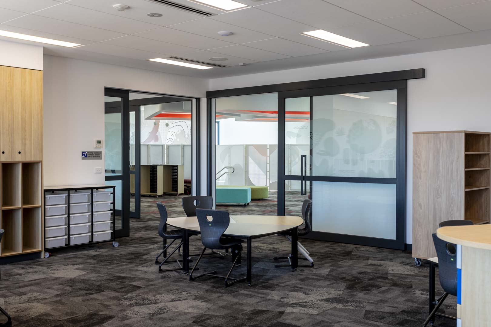 image of several acoustic sliding doors in a grammar school to create flexible learning spaces
