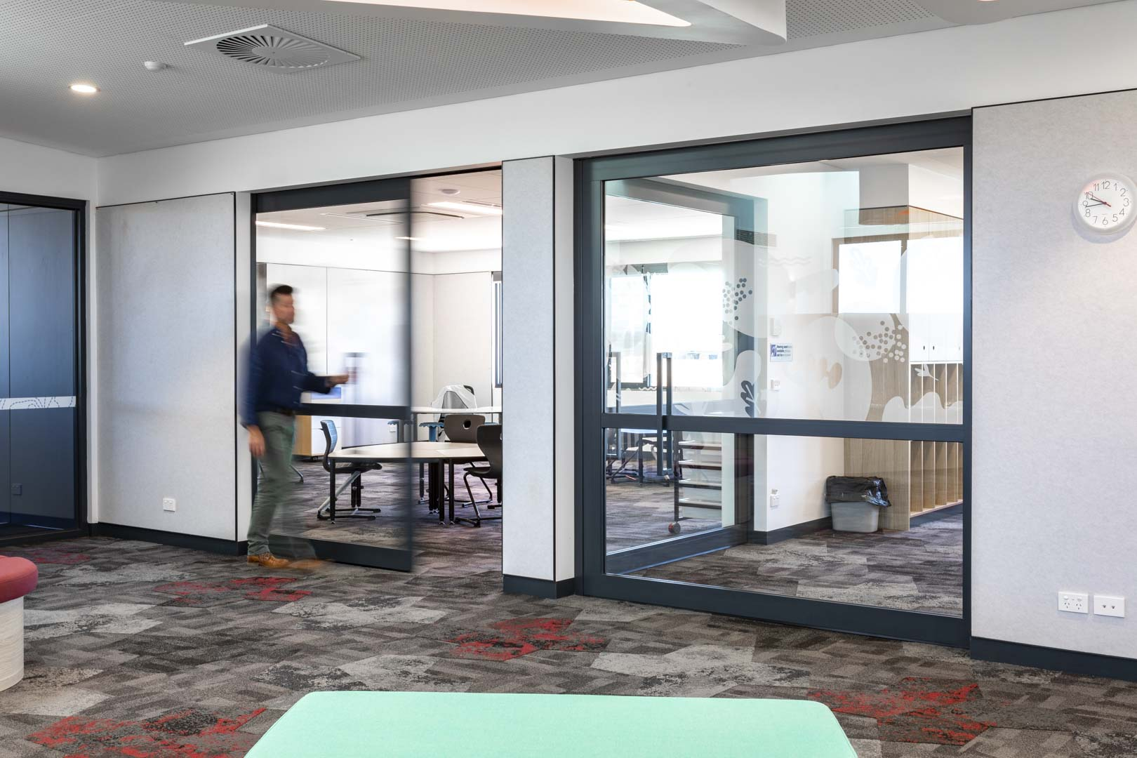 image of two acoustic sliding doors designed to create flexible learning areas in a school