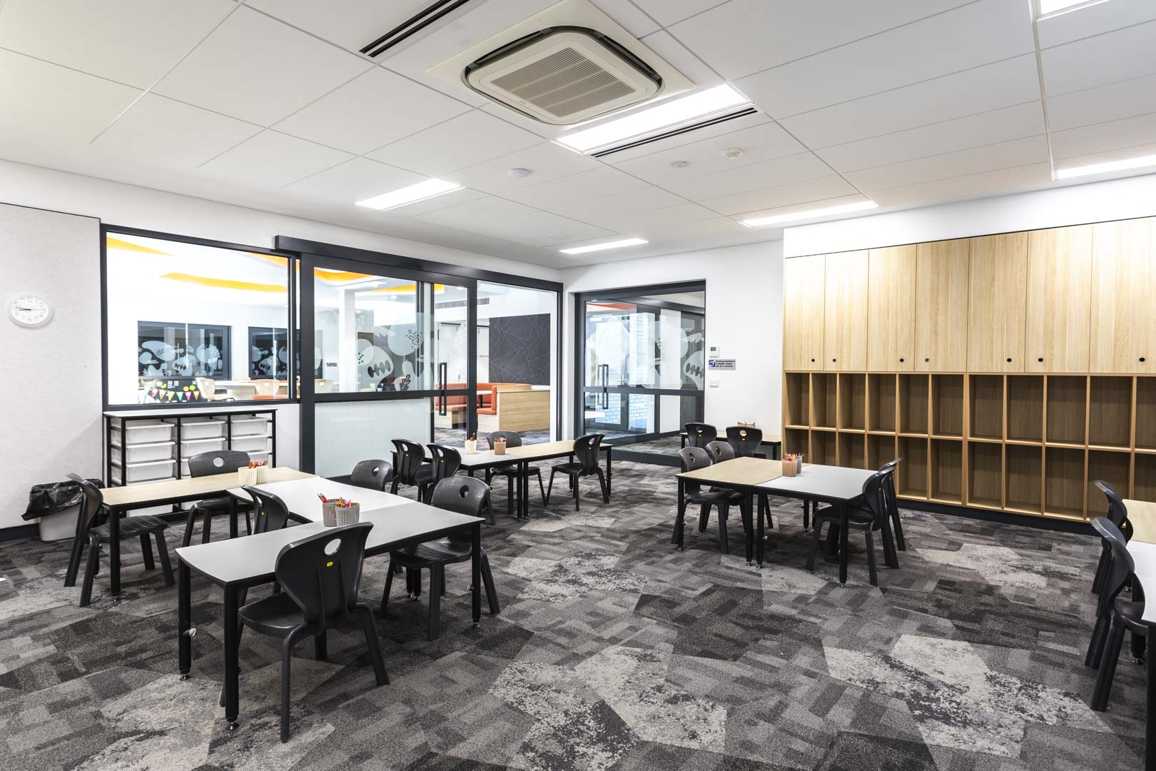 image of a flexible learning area with glazed acoustic sliders