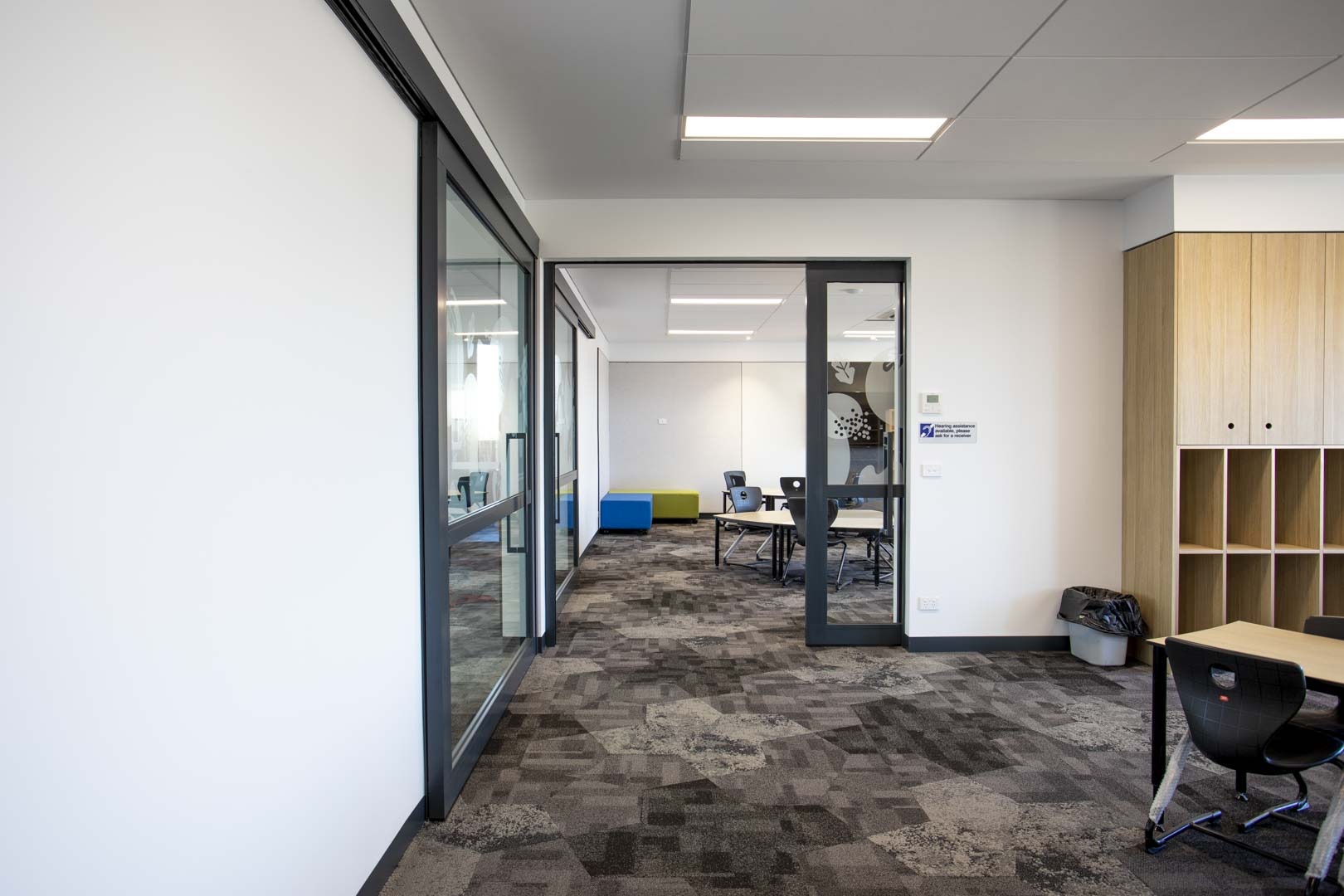 image of glazed acoustic sliders inside a primary school's general learning area