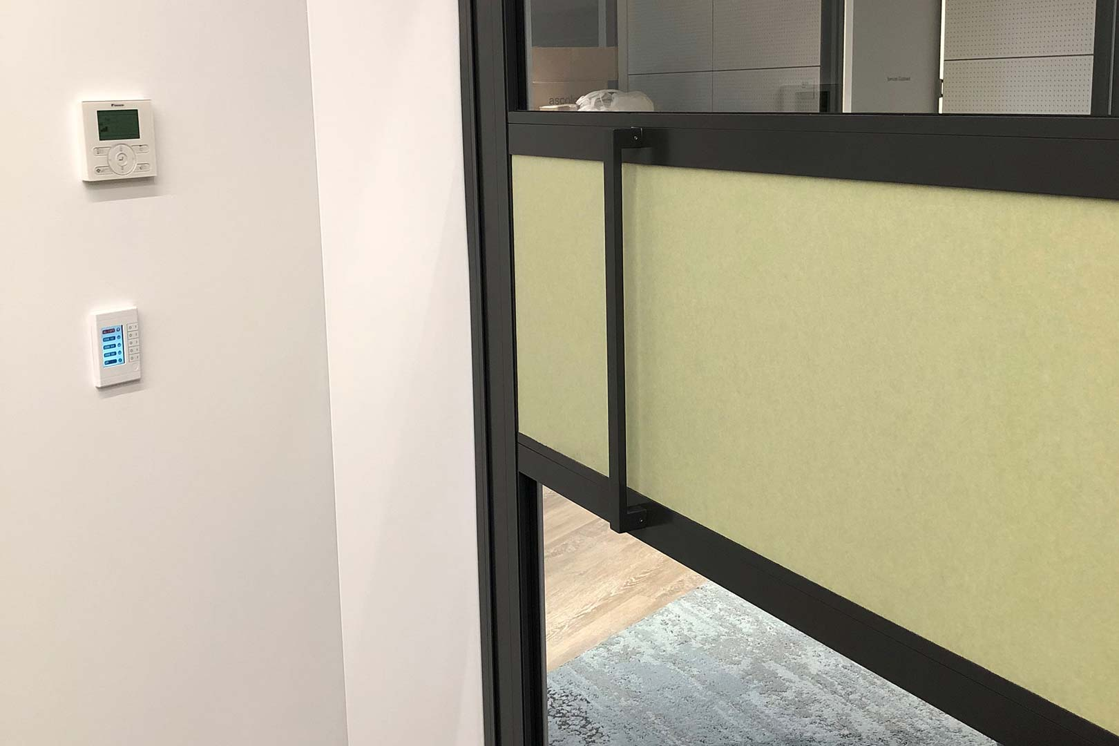 image of the handle on a GLYDE acoustic sliding door system