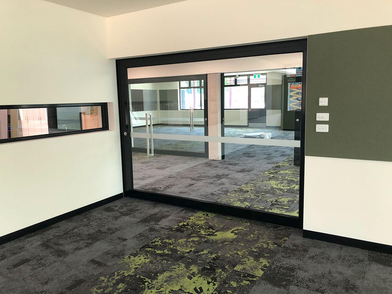 image of DDA compliant glazed acoustic sliding door system