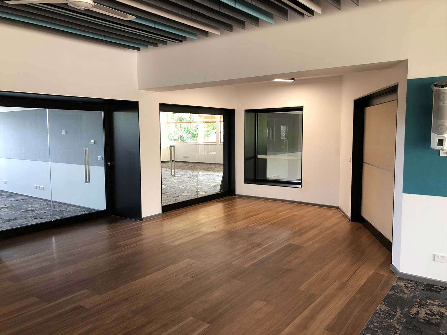 image of three acoustic sliding door systems installed in a primary school