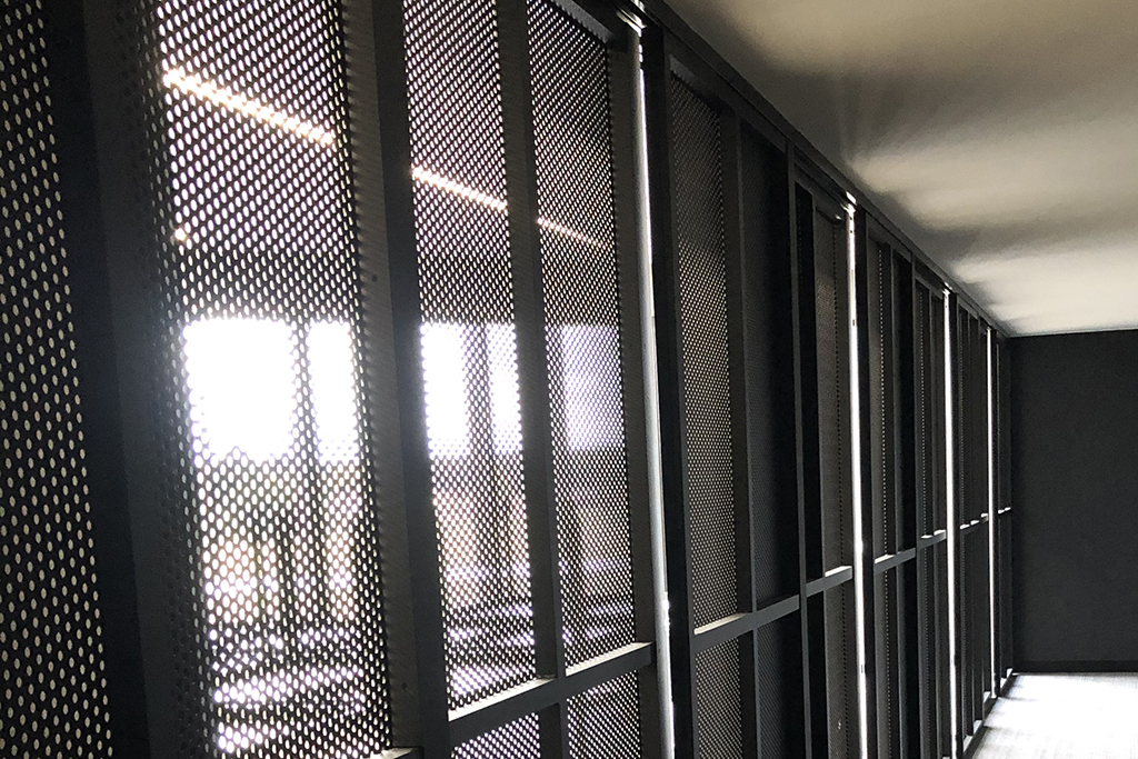 GLYDE decorative screen system for flexible spaces