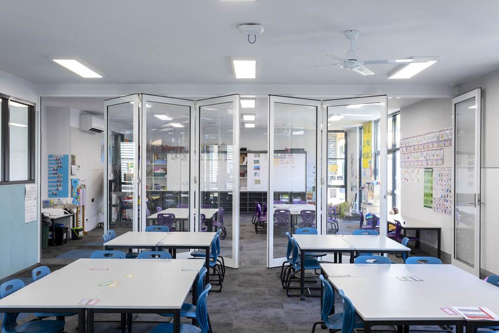 image of open single glazed doors installed in a primary school