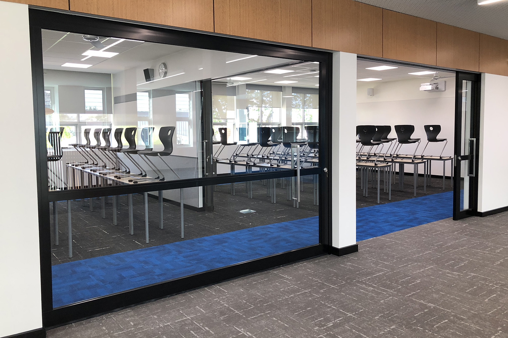 image of acoustic sliding doors installed inside a secondary school
