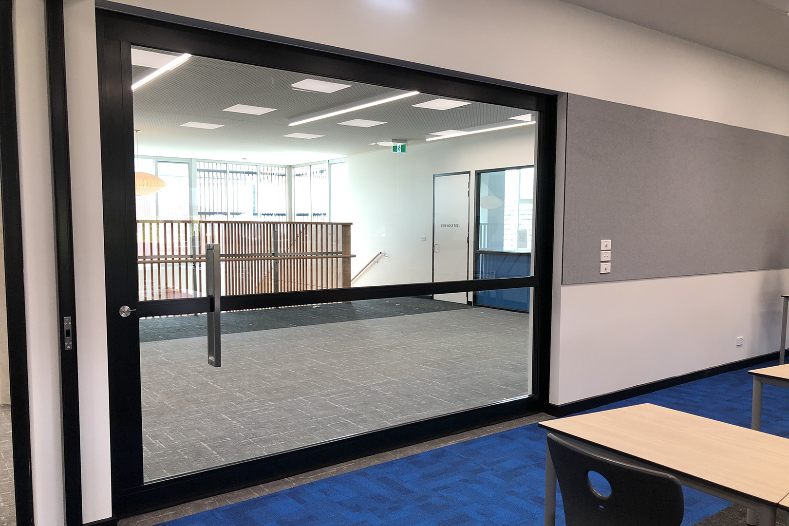 image of acoustic sliders in a school used to create flexible learning rooms