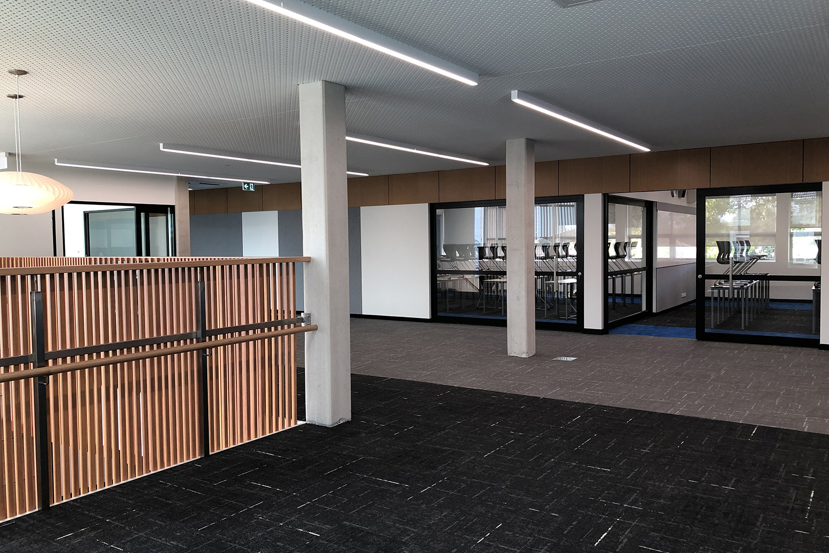 image of acoustic sliding doors installed at a secondary school